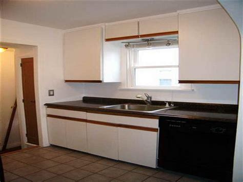can you paint laminate cabinets spray paint kitchen cabinets spray painting kitchen