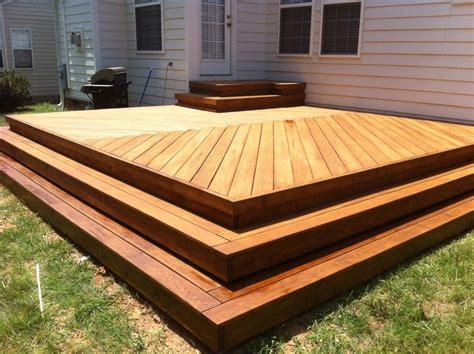 wrap around deck designs new deck with herringbone decking pattern no railing with wrap around steps deck ideas