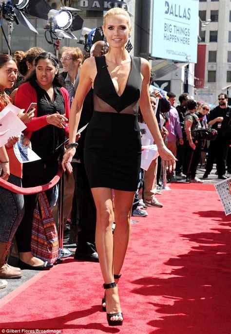 Heidi Klum Wows Black Dress Joining Mel Agt Event