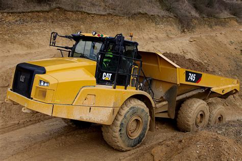 cat unveils redesigned  articulated truck  larger