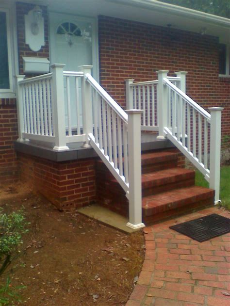 white railing on a concrete porch boling front porch
