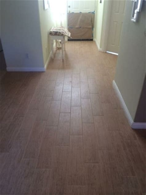 24 inch tile 6 by 24 inch porcelain wood tile with 1 8 inch grout lines on 30 percent stagger new baseboards