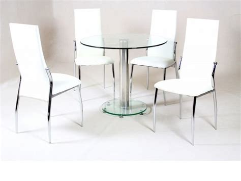 small clear glass dining table and 4 faux chairs in