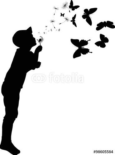 "child silhouette blowing on black dandelion"" Stock image"