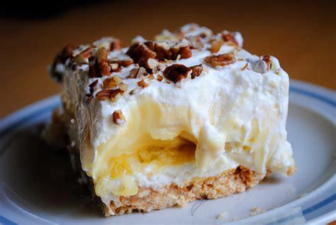 banana split cake nilla wafers sugar butter cheese crushed pineapple bananas milk