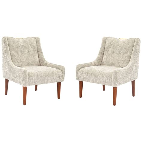 pair of faux fur brass and mahogany occasional chairs for