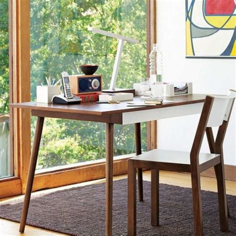 minimalist wooden desk and wood chair with big window in