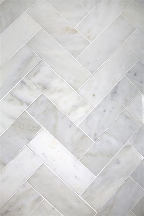 herringbone marble floor try this herringbone marble tile a beautiful mess bloglovin