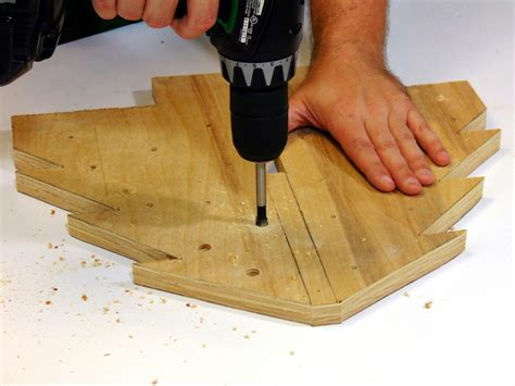 drilling holes in christmas tree how to build a wooden tree centerpiece how tos diy