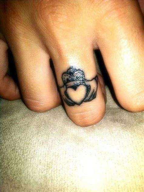 rocking couple  astonishing ring tattoos