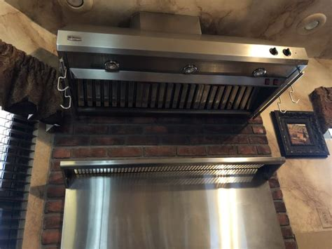 ge monogram  dual fuel professional range  ovens hood  gas burners griddle  electric