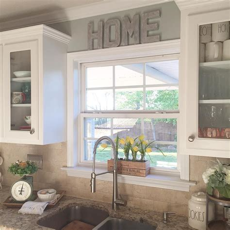 ideas for kitchen windows i like the raised window and the glass cabinets around it