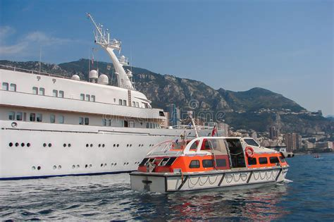 Yacht Lifeboat by Boat Alongside Big Yacht Ship Stock Image Image Of