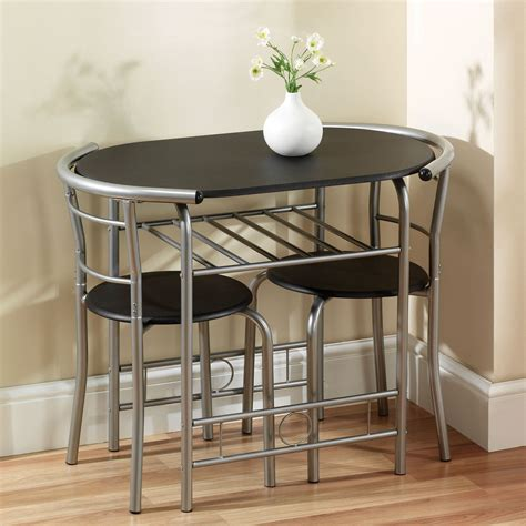 Oval Black Wooden Table With Silver Steel Long Legs And
