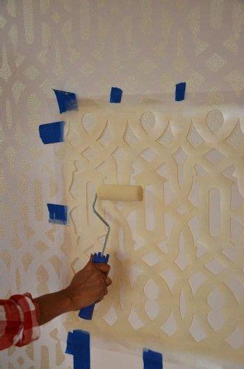 glamorous trellis stenciled accent wall metallic paint