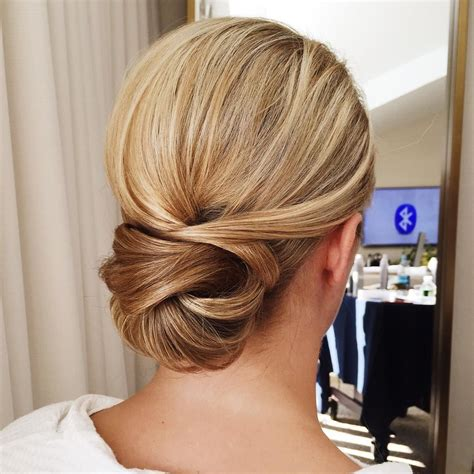 one of my bridesmaids from today s wedding a simple low bun with simply a lot of product