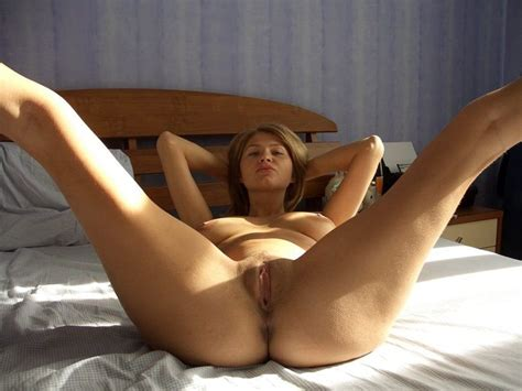 Horny Wifey Posing Naked On The Bed While Husband At
