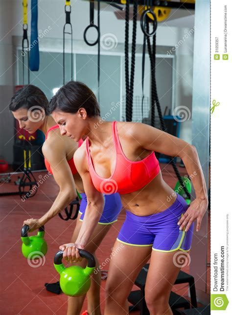 crossfit woman lifting kettlebell workout mirror fitness preview