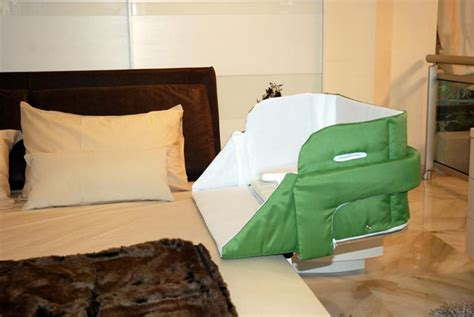 The Culla Belly Co-sleeper Attaches Onto Beds For Easy Access