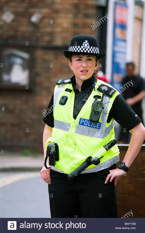 Police Woman In Ross On Wye Closing A Road For The Annual Carnival Stock Photo Royalty Free