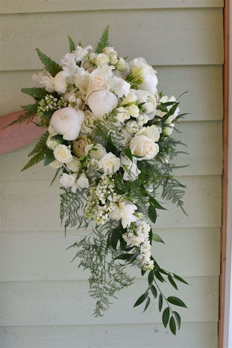 Beautiful Bouquet Cascading In Spring Flowers Including