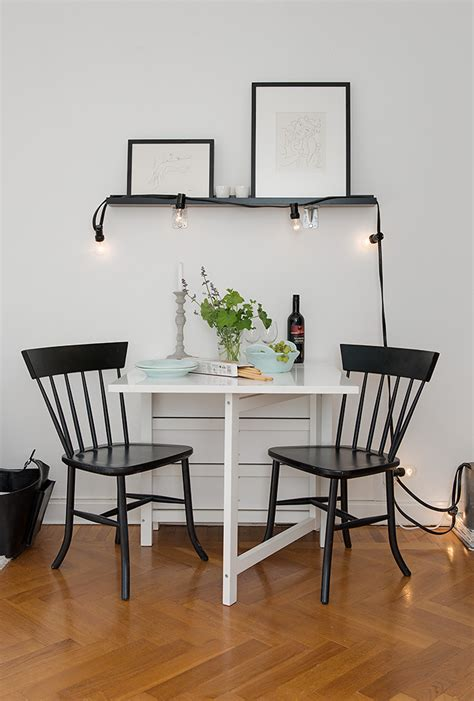black and white dinette dining room small dining table black chairs tiny apartment