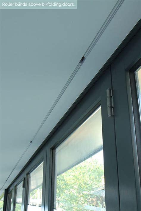 concealed roller blinds  bi folding doors shades hidden lutron blindspace detail