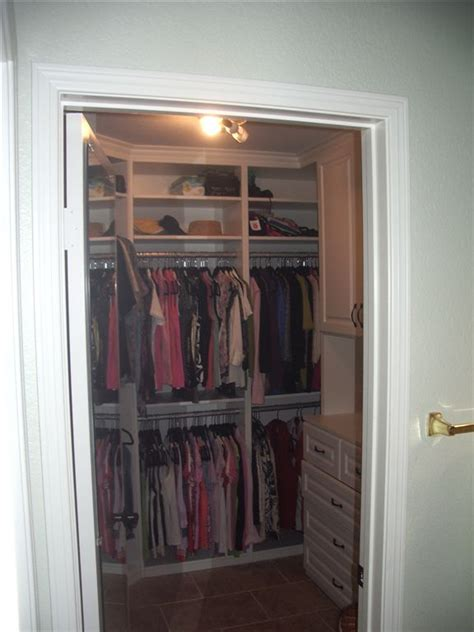 built in walk in closet with extensive hanging storage