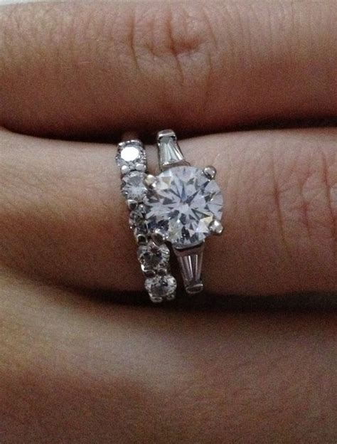 round diamond with baguettes engagement ring and small