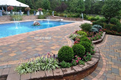 back yard pool design paving patio island