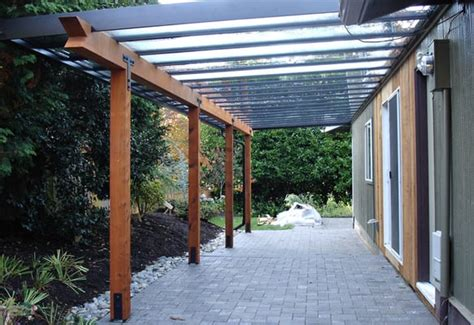 black aluminum patio cover with glass infill and wood yelp