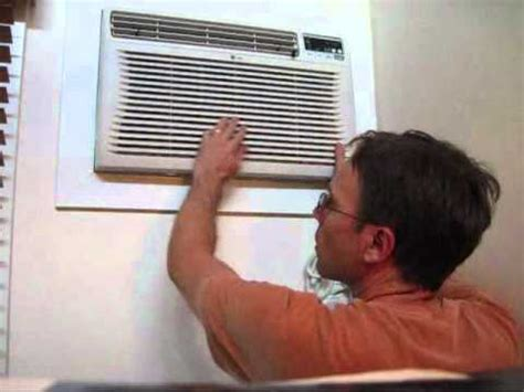 installing   air conditioner ac wall unit part  putting  ac unit   wall youtube
