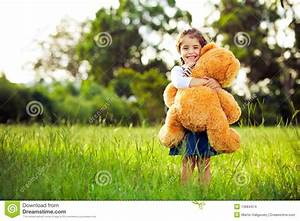 Little Cute Girl Holding Teddy Bear Stock Photo - Image ...
