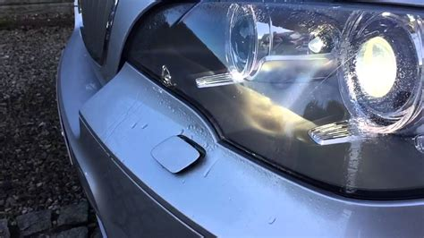 bmw     sport bi xenon headlight washers slow motion youtube