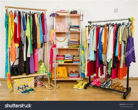 Colorful Closet by Wardrobe With Summer Clothes Nicely Arranged Dressing