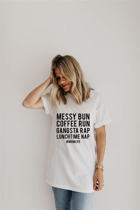 2 days ago · when it comes to hair trends, there are few that surpass the effortless glam of messy hairstyles. Tshirt: messy bun... #momlife   T shirts for women, Unisex ...