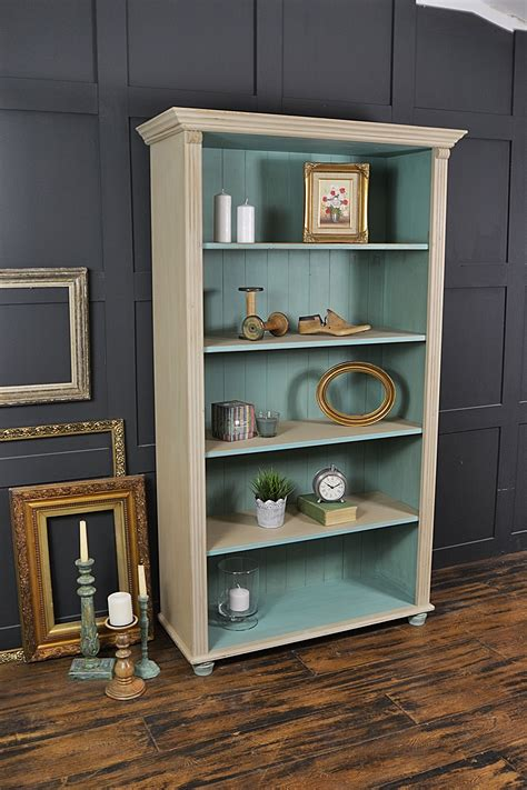 this farmhouse pine bookcase has been painted in