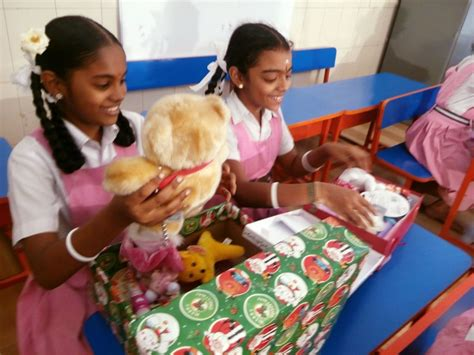 indian school children receive christmas gifts from