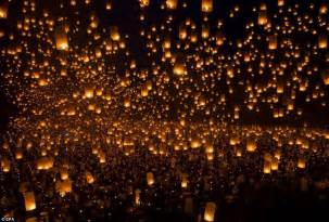 spectacular images thousands of students release lanterns into the sky in new world
