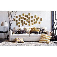 white slipcovered sofa natural fiber rug lucite coffee
