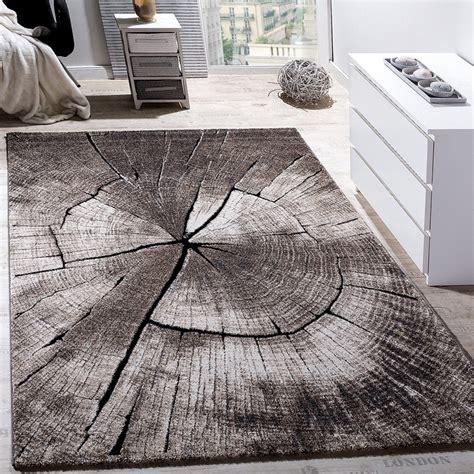 rug lounge tree trunk grey brown rug