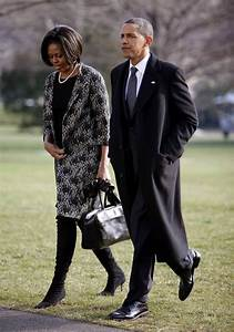 President Obama and First Lady Michelle Obama walk across ...