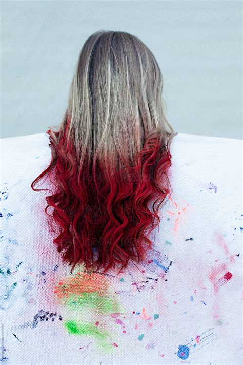 Long Blonde Hair With Red Color Sprayed On The Ends Dip
