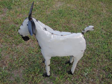 goat metal yard art car interior design