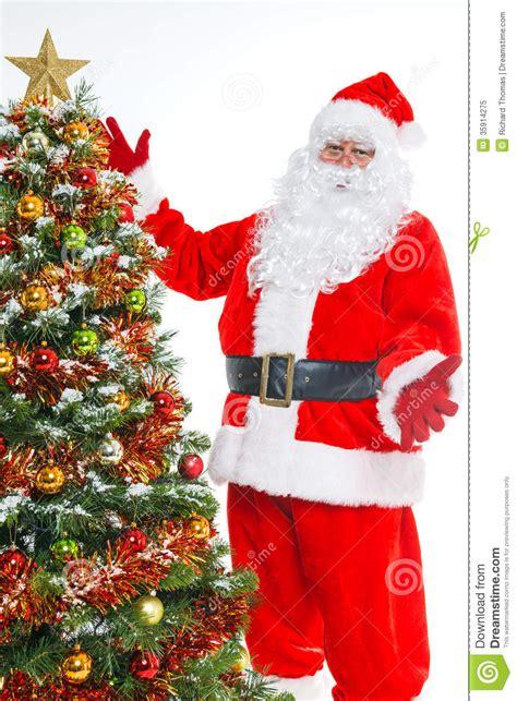 photo of santa claus and christmas tree santa and tree isolated stock image image of tree 35914275