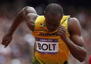Bolt Sets Up Showdown With Blake In 200m Final