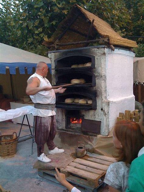 huge baker dude outdoor oven fire inspiration pizza