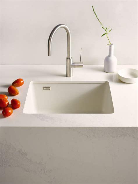 caesarstone pure white sink caesarstone calacatta nuvo countertops  caesarstone kitchen