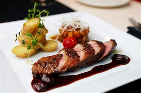 apprendre a cuisiner marocain crispy duck breast with cherry port sauce recipes