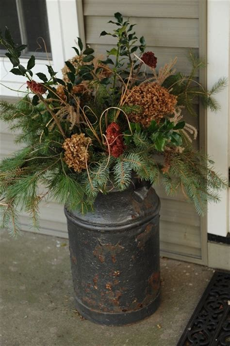 christmas milk can ideas pinterest winter porch arrangement i my in laws milk can from their farm and this would be a great